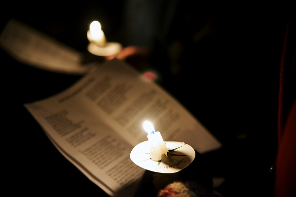 <p><p>Sheet music is lit up by a candle. (Bas Slabbers/for NewsWorks)</p></p>