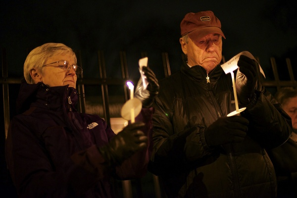 <p>Names of victims of the Sandy Hook shooting are read by people attending the vigil. (Bas Slabbers/for NewsWorks)</p>