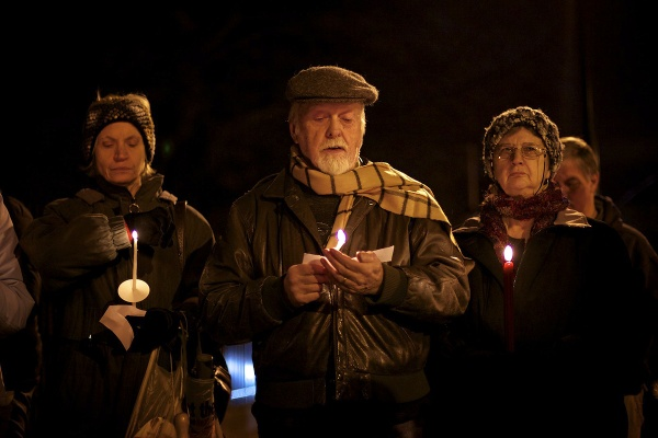 <p>Bruce McNeel reads one of the names. (Bas Slabbers/for NewsWorks)</p>