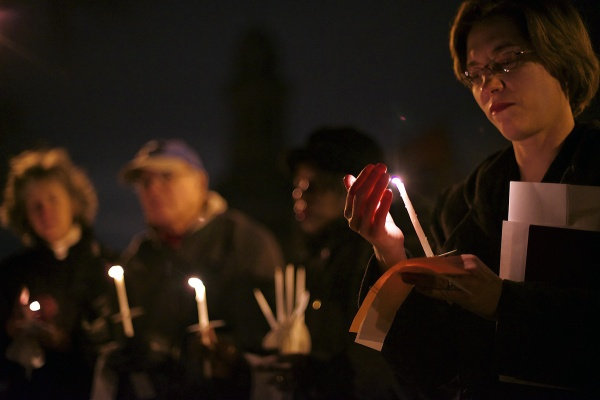 <p><p>Rev. Lorelei Toombs of First United Methodist Church of Germantown protects her candle from the wind. (Bas Slabbers/for NewsWorks)</p></p>