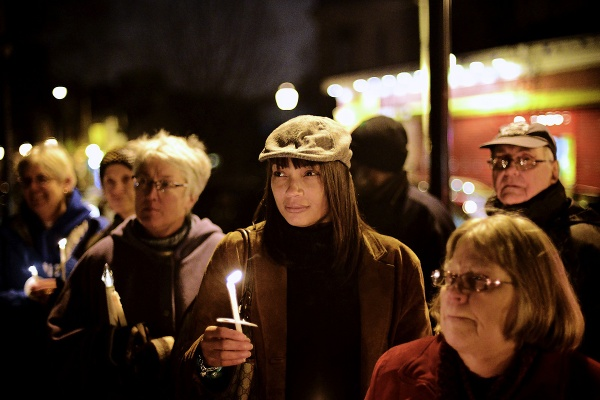 <p>Vicky Miles (middle) from East Falls says that children need education to have a fighting change in this world. (Bas Slabbers/for NewsWorks)</p>