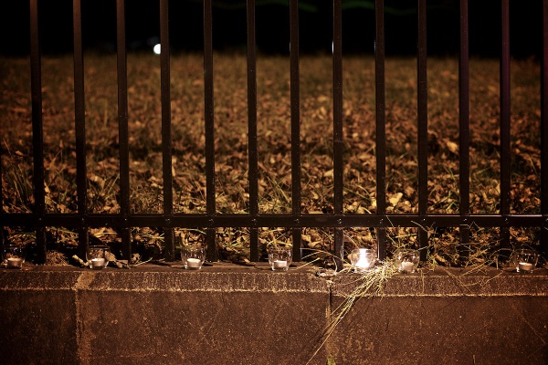 <p><p>One candle is still lit. The others along the gate got blown out. (Bas Slabbers/for NewsWorks)</p></p>