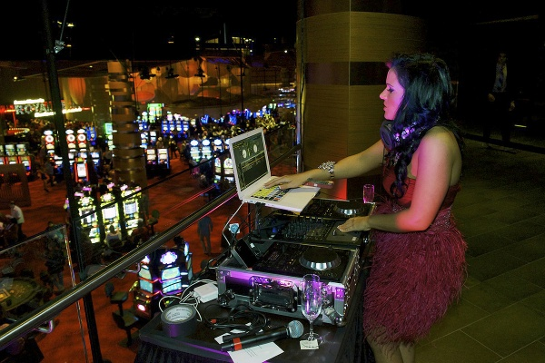 <p><p>Standing on the balcony this DJ provides music for the gambling floor. (Bas Slabbers/for NewsWorks)</p></p>