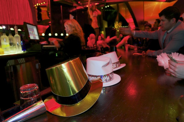 <p><p>New Year hats lay on the bar of the Burlesque area. (Bas Slabbers/for NewsWorks)</p></p>