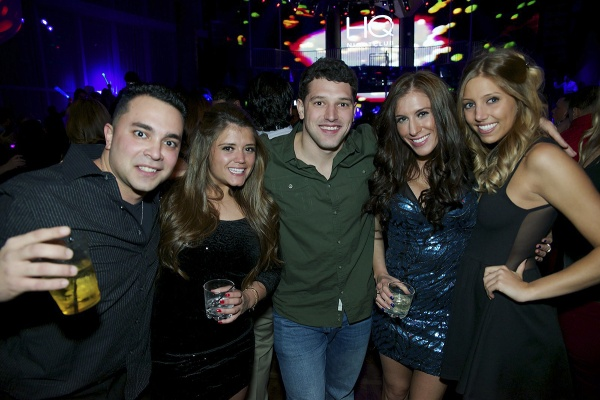 <p>A group of friends smiles at the camera at the HQ Nighclub as the early hours of 2013 tick away. (Bas Slabbers/for NewsWorks)</p>