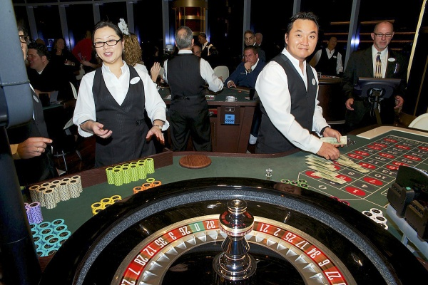 <p><p>Dealers at work at one of the tables of the Revel Casino. (Bas Slabbers/for NewsWorks)</p></p>