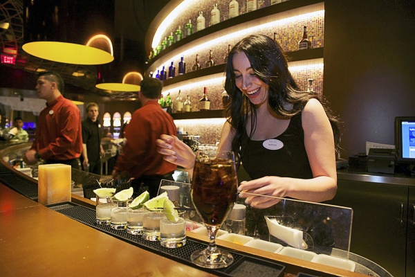 <p><p>Morgan works at the bar in one of the lounge areas. (Bas Slabbers/for NewsWorks)</p></p>