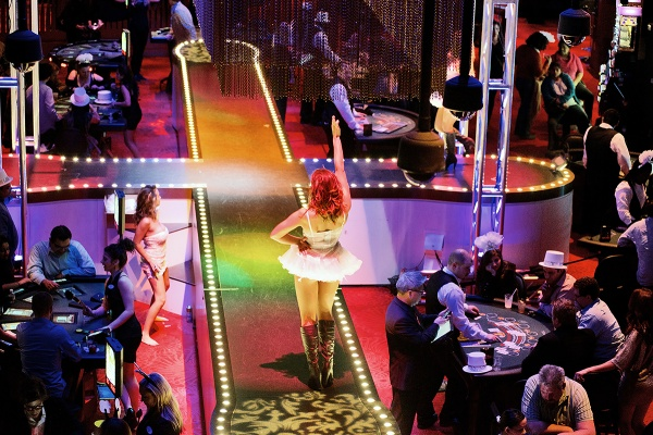 <p>A burlesque performer is seen on a cross shaped stage area in the middle of the Digipit game area at the Revel casino. (Bas Slabbers/for NewsWorks, file)</p>