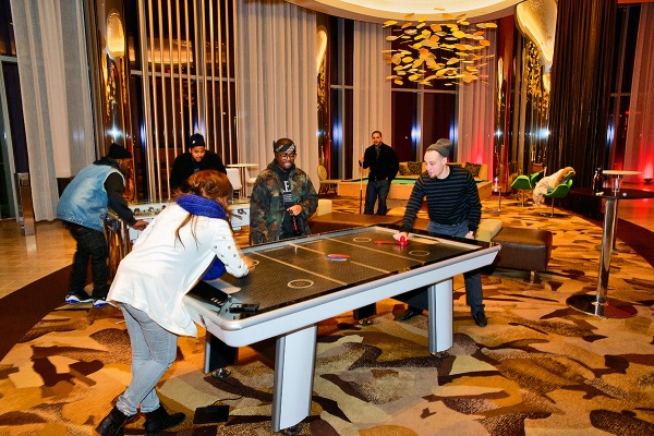 <p>This group of friends found games to enjoy themselves at the O2 lounge area at the Revel Resorts complex. (Bas Slabbers/for NewsWorks, file)</p>