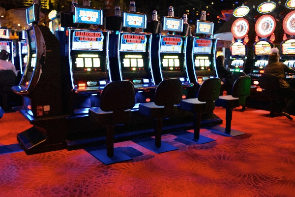 <p>A row of slot machines on the casino floor of Revel Resorts and Casino. (Bas Slabbers/for NewsWorks, file)</p>
