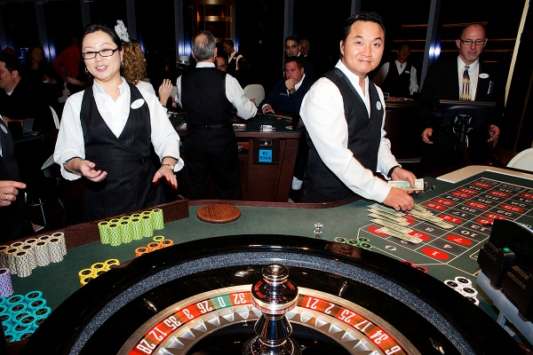 <p>Dealers at work at one of the tables of the Revel Casino. (Bas Slabbers/for NewsWorks, file)</p>
