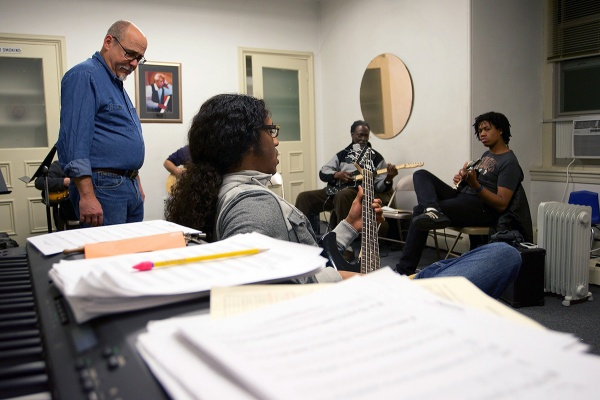 <p>Ed Wise (left) teaches a guitar class at the Settlement Music School in Germantown. (Bas Slabbers/for NewsWorks)gp</p>