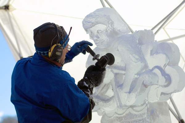 <p><p>Ice Sculptor Kevin Roscoe from Seattle, Washington, makes final touches on his artwork on Saturday. (Bas Slabbers/for NewsWorks)</p></p>