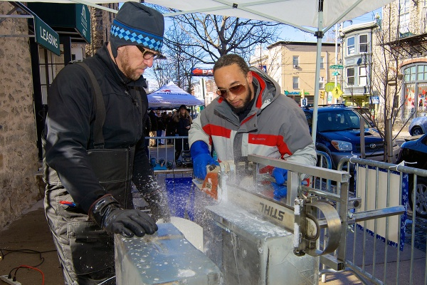 <p><p>Peter Slavin and Don Harrison use an Alaskan Mill saw to split a large block of ice. (Bas Slabbers/for NewsWorks)</p></p>