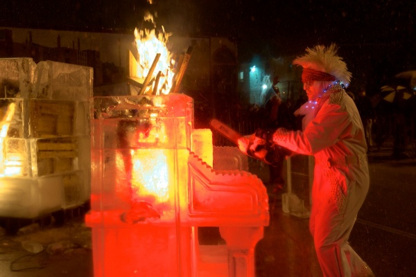 "<p><p>The ice piano goes up in flames as the song ""Great balls of Fire"" plays over the speaker. (Bas Slabbers/for NewsWorks)</p></p>"