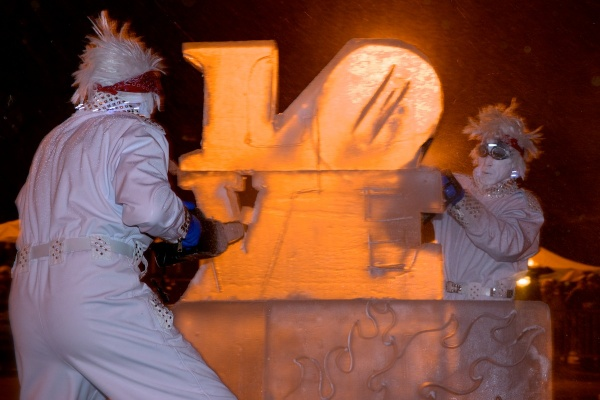 "<p><p>A chainsaw and blowtorch are used to carve out the letters ""L O V E"" from a block of ice. (Bas Slabbers/for NewsWorks)</p></p>"