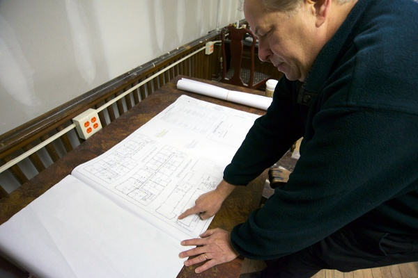 <p><p>Kroungold reviews plans for the apartments on the second and third floors of the building. (Bas Slabbers/for NewsWorks)</p></p>