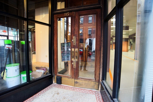 <p><p>The former front door of the building is now the entrance to the yoga studio. The other business can be reached from the Cresson Street side. (Bas Slabbers/for NewsWorks)</p></p>