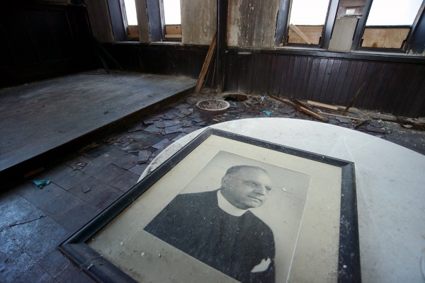 <p><p>A portrait of Rev. Edward H. Vogt, rector from 1931 to 1954, was left behind. (Bas Slabbers/for NewsWorks)</p></p>