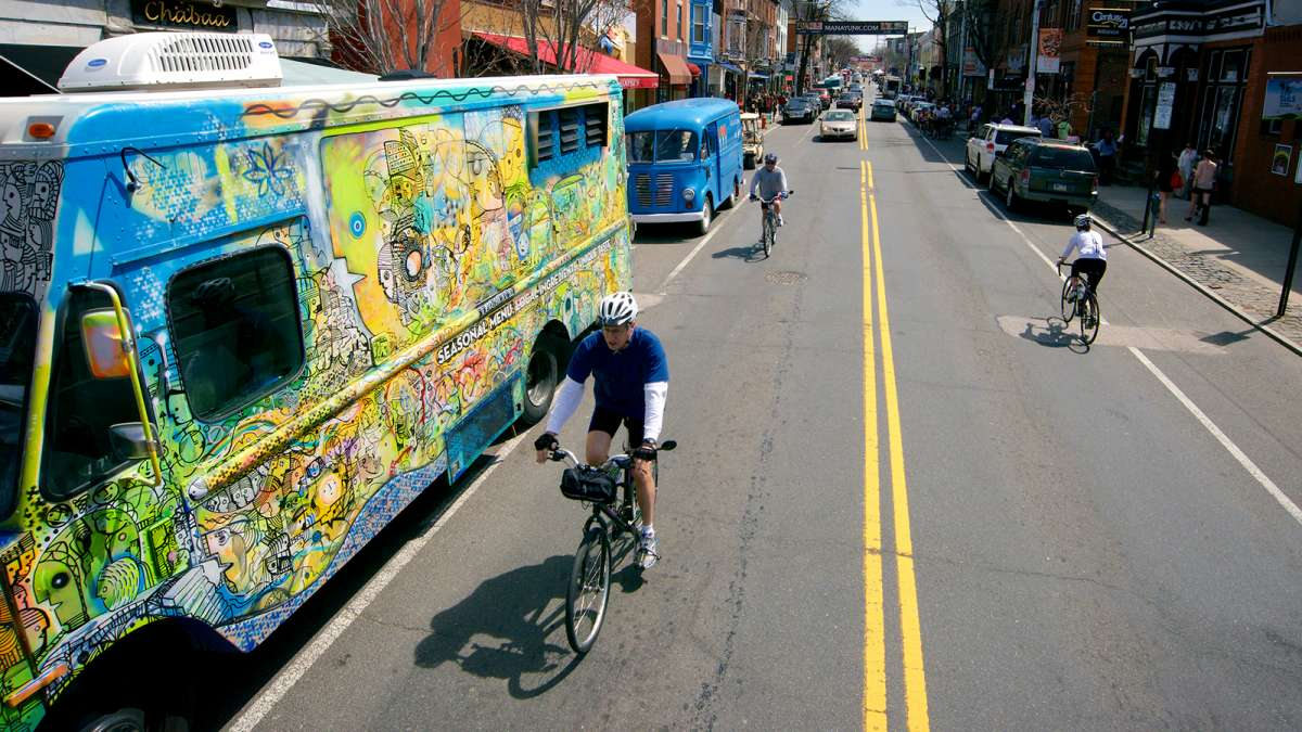 Food trucks line both sides of Manayunk's Main Street (Bastiaan Slabbers for WHYY)