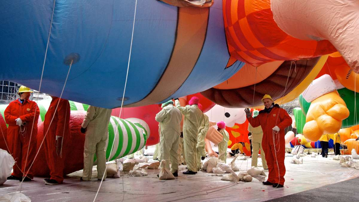 A scene before the start of the parade, as the balloons still sit on tarps on the street. (Bas Slabbers/for NewsWorks)