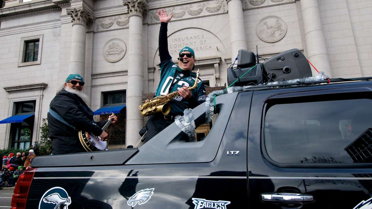 A band in Eagles gear performed from the back of a pick-up. (Bas Slabbers/for NewsWorks)