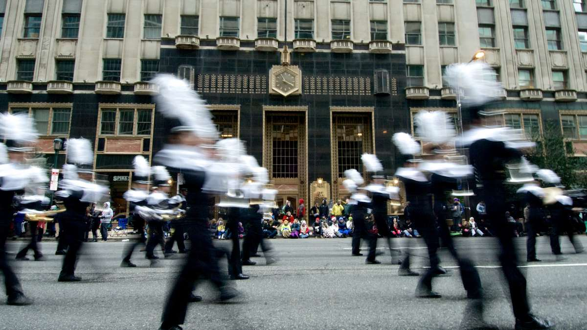 One of the marching bands is seen passing Suburban Station on Market Street. (Bas Slabbers/for NewsWorks)