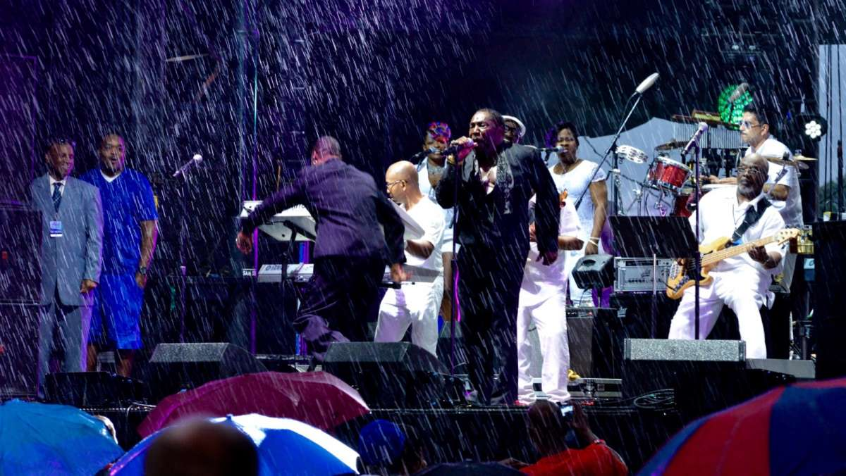 Umbrellas go up once the rain comes down during a tribute to Kenny Gamble and Leon Huff celebrating the Sound of Philadelphia.