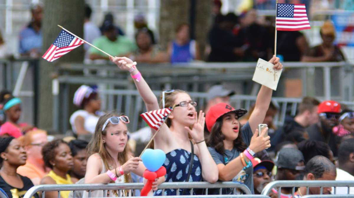 Flag waving fans cheer as Yazz the Greatest and Leslie Odom Jr. kick off the Wawa Welcome America 4th of July Concert on the Parkway.
