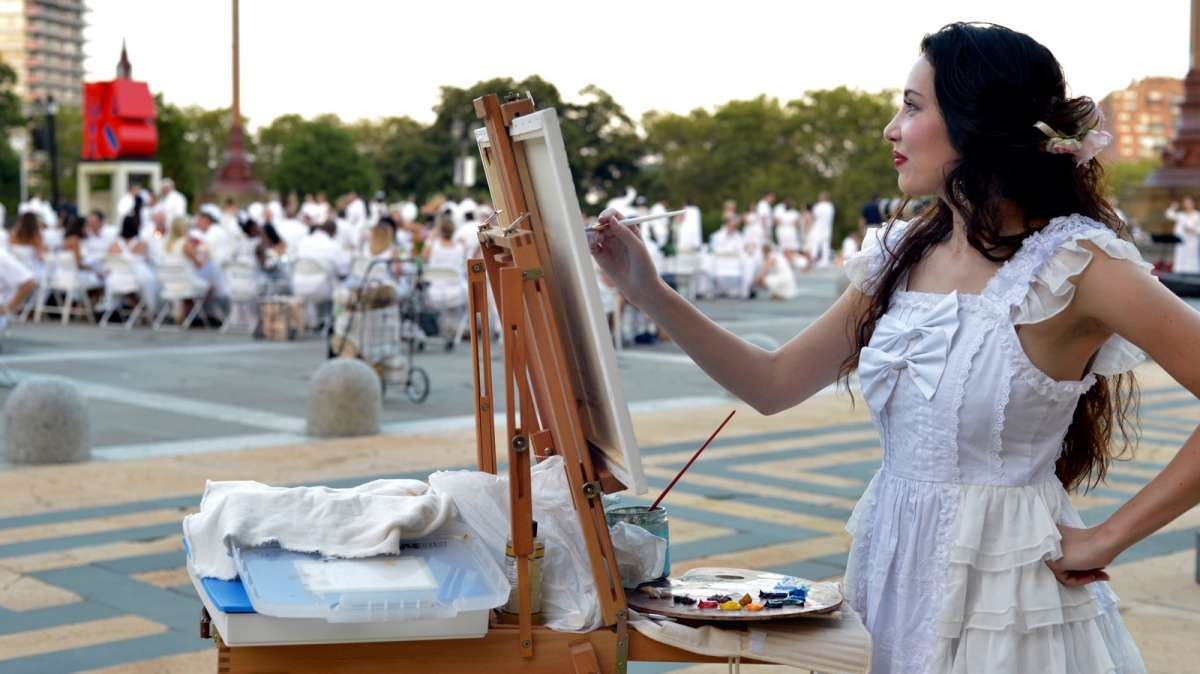 Jessica Libor sets up a painter's easel to capture the scene in oils.