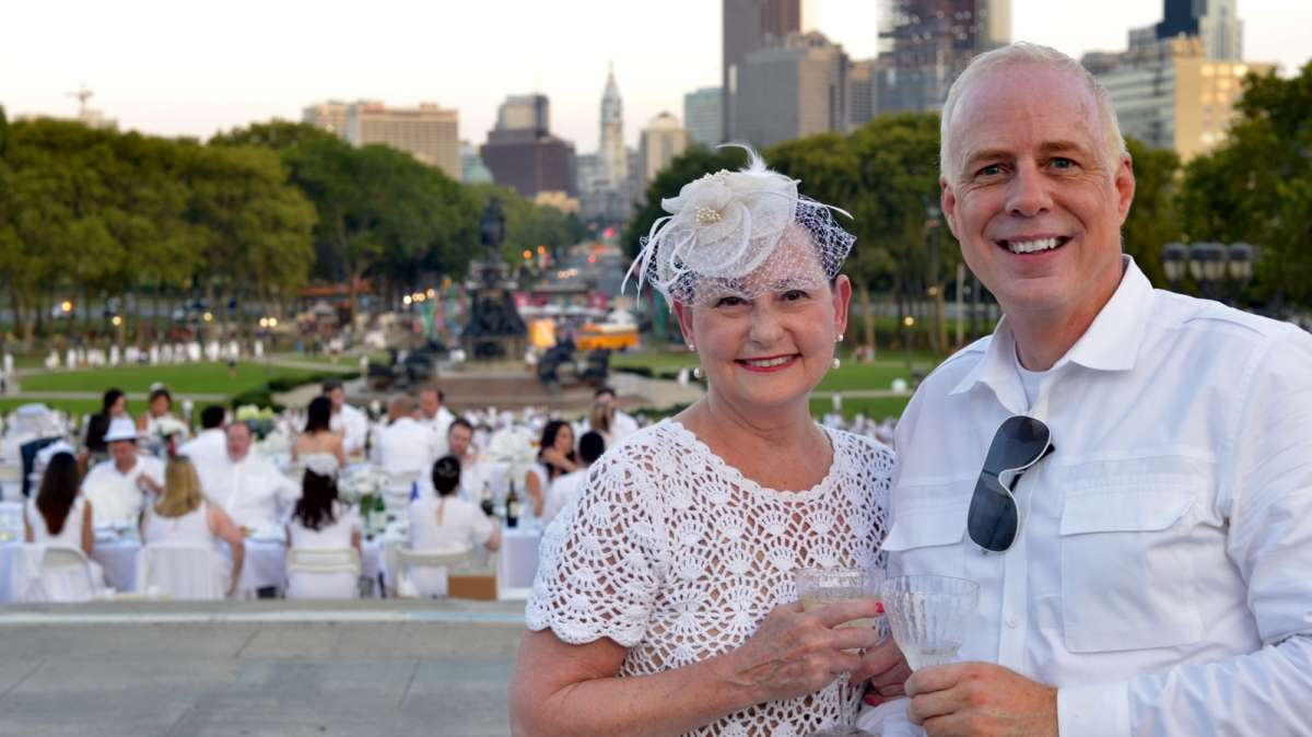 Goldie Brown and Mark Beyerle, of Center City, pose for a photo atop the art museum Steps.