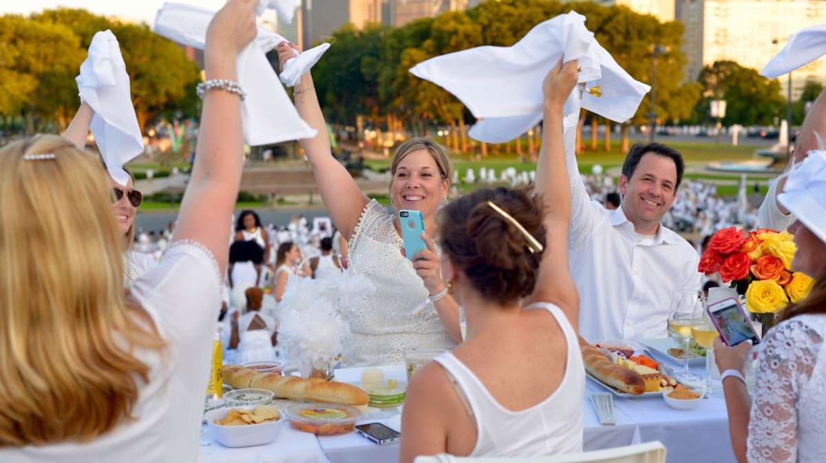 Guests wave their white napkins to signal the start of this year's Dîner en Blanc.