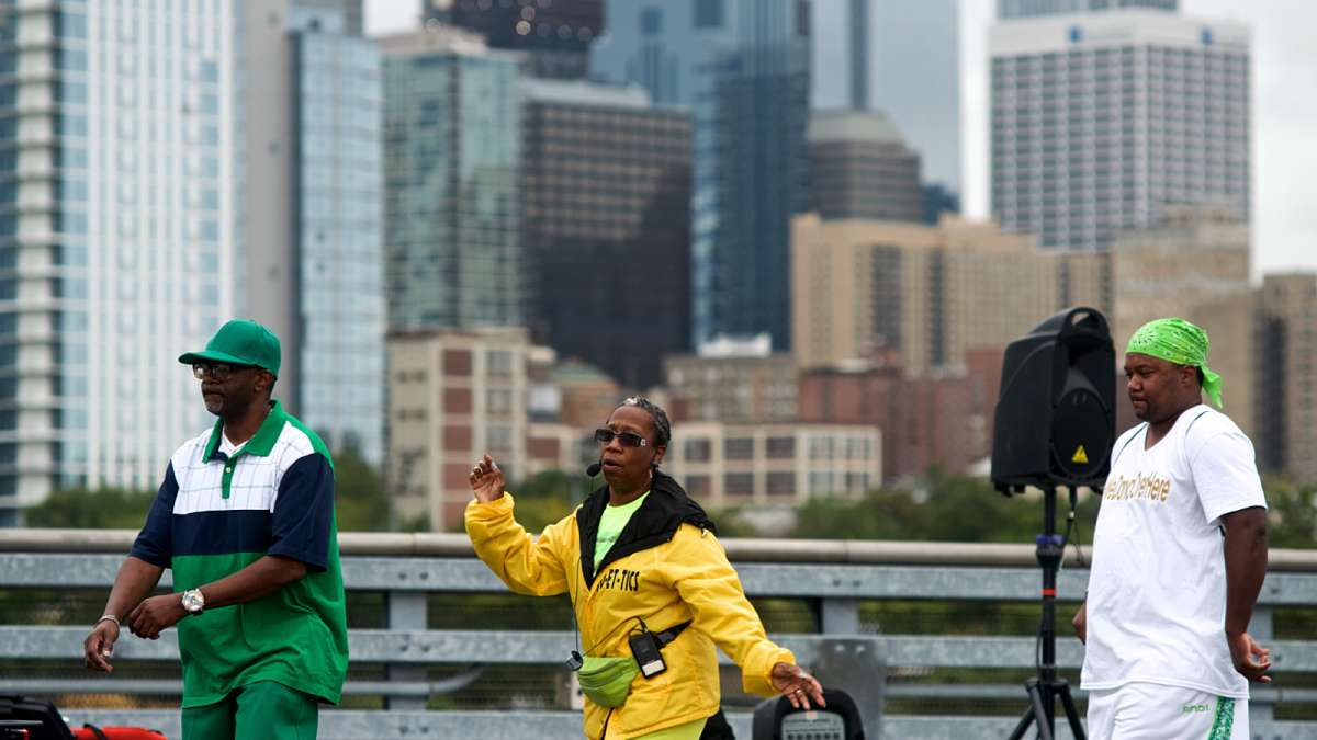 The Center City skyline forms the backdrop for Line Dancing with a View, hosted by JO-ET-TICS Dance on South Street Bridge during during the Philly Free Streets day.