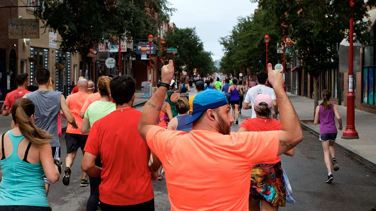 Joggers take off for a morning run over a car-free South Street during the Philly Free Streets Day.