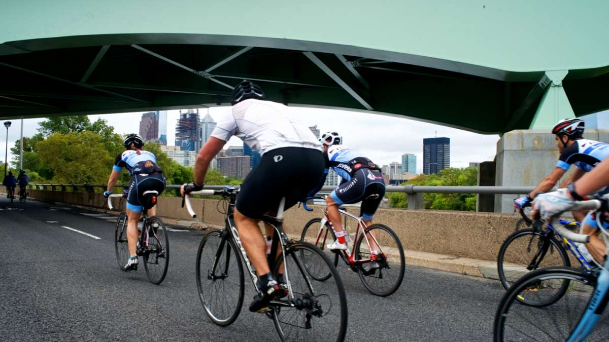 The temporary car-free zone at South Street is connected by the Schuylkill River Trail to Martin Luther King Jr. Drive, creating a ten-mile-long haven for cyclists. (Bastiaan Slabbers for NewsWorks)