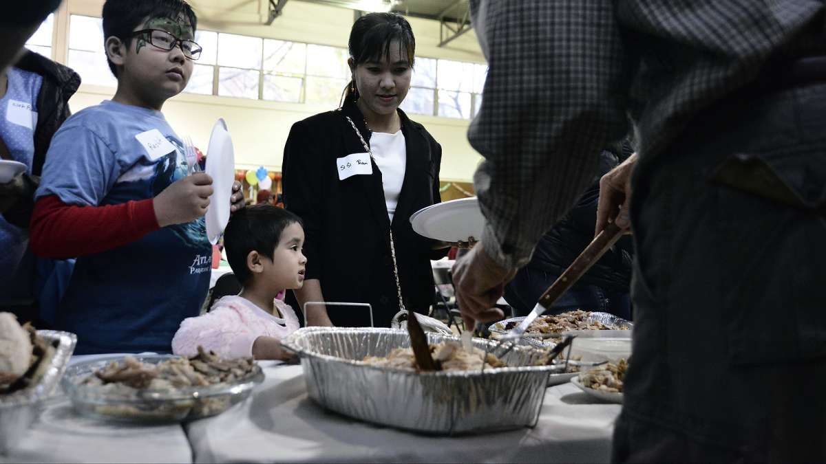 There were plentiful options to choose from at the annual Thanksgiving dinner for refugees at the Old Pine Community Center on Sunday. (Bastiaan Slabbers for NewsWorks)