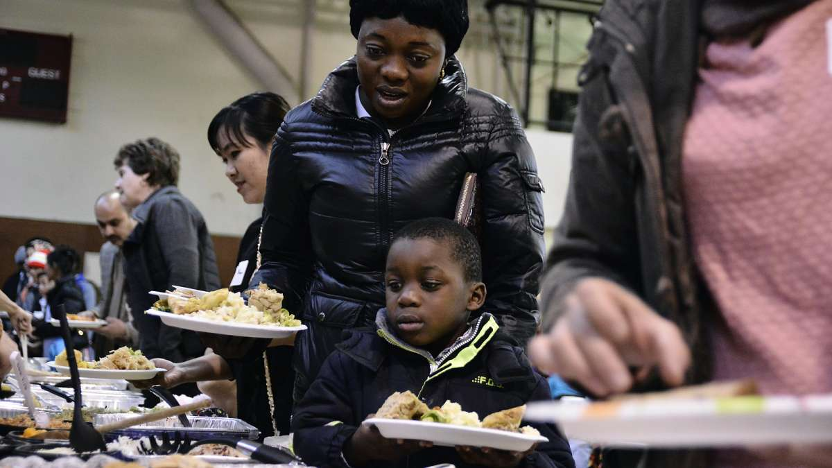 Carine Nyembo and son Daniel, 5, choose from the many options at the buffet. (Bastiaan Slabbers for NewsWorks)