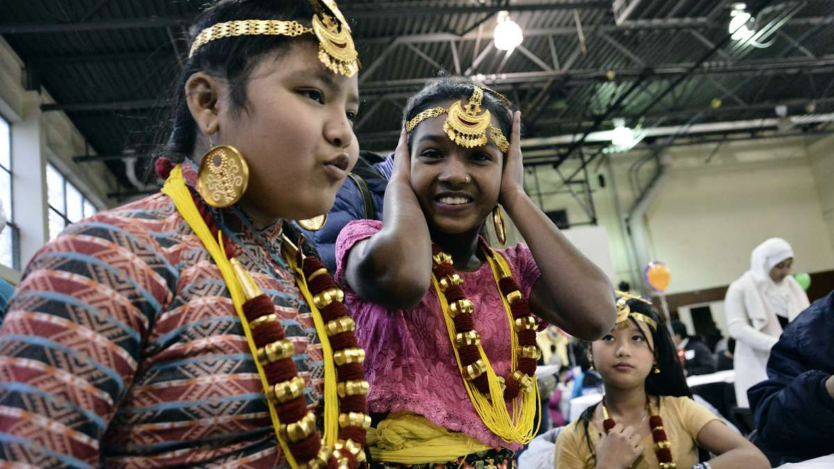 Members of the Rai family from Nepal wore colorful attire as they attended their first Thanksgiving dinner at Old Pine Community Center on Sunday. (Bastiaan Slabbers for NewsWorks)