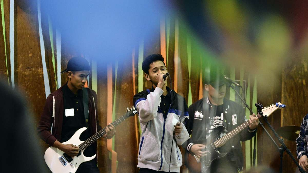 Neil Young's ''Rocking in the Free World'' is performed by a local high school band during the eighth annual Thanksgiving dinner for refugees at the Old Pine Community Center on Sunday. (Bastiaan Slabbers for NewsWorks)