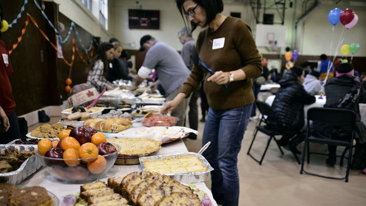 Traditional and non-traditional Thanksgiving dinner offerings are spread out buffet-style. (Bastiaan Slabbers for NewsWorks)