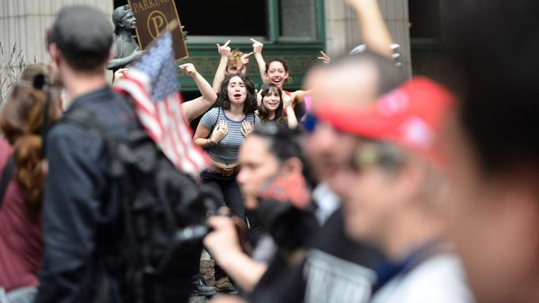 Demonstrators who support President Donald Trump and those protesting his policies converge in Philadelphia Saturday. (Bas Slabbers for NewsWorks)