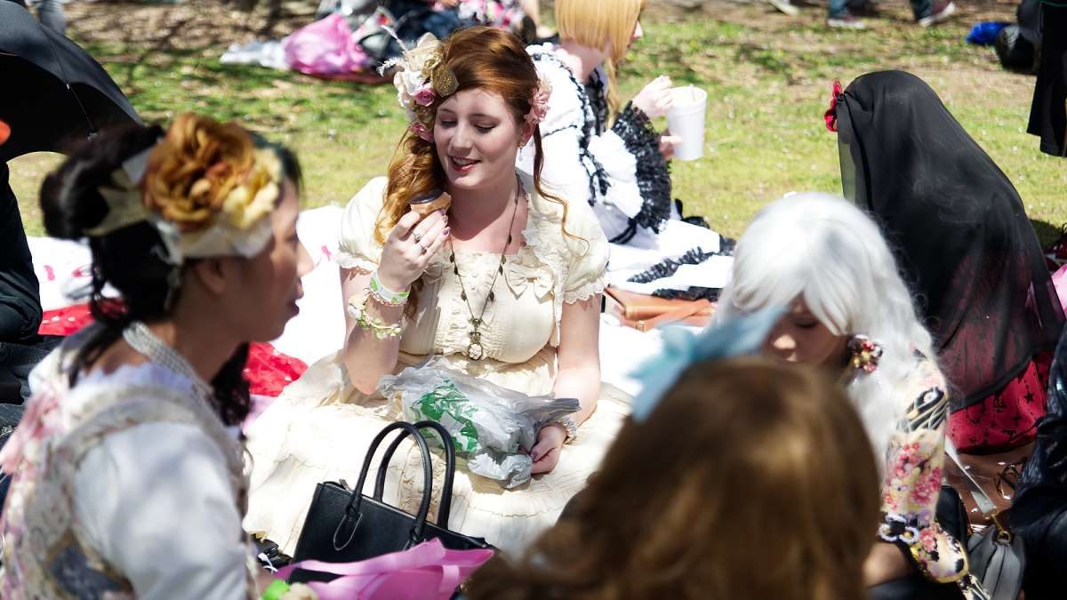 Dressed in Japanese fashion members of Frilladelphia sit on the lawn under the Sakura trees, during the annual Cherry Blossom festival, in Fairmount Park, on Sunday.