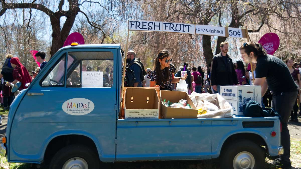 A nearly 50-year-old tiny Japanese pickup truck serves as a fresh fruit stand during the annual Cherry Blossom Festival in Fairmount Park on Sunday.