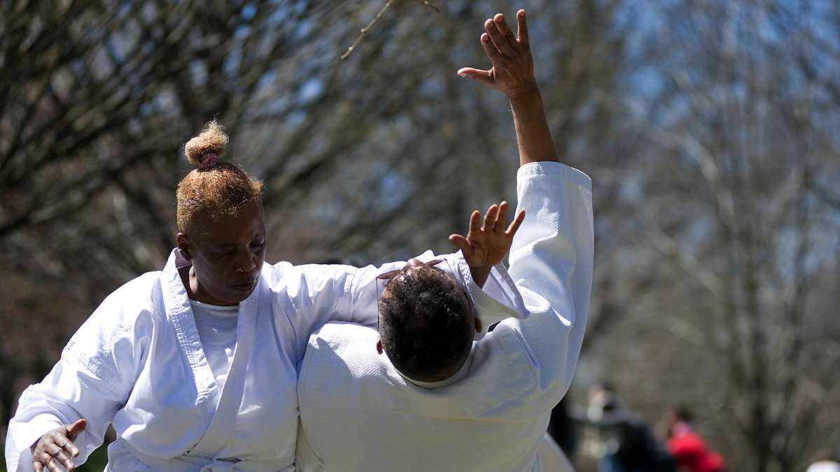 Rick and Sandra Hill, of Philadelphia, rehearse martial arts routines before participating in a Doshinkan Aikido demonstration on stage during the annual Cherry Blossom Festival in Fairmount Park on Sunday.