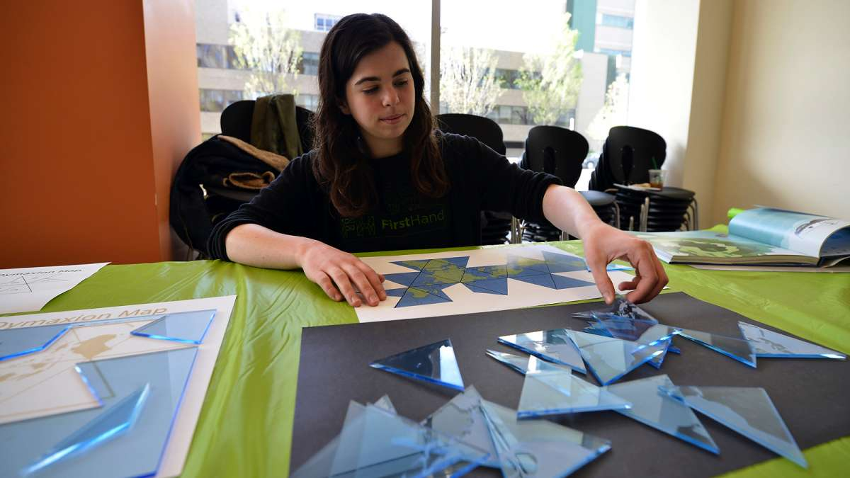 Katie Rowlett works on a puzzle inspired by innovator Richard Buckminster Fuller at Microsoft Reactor at the University City Science Center.