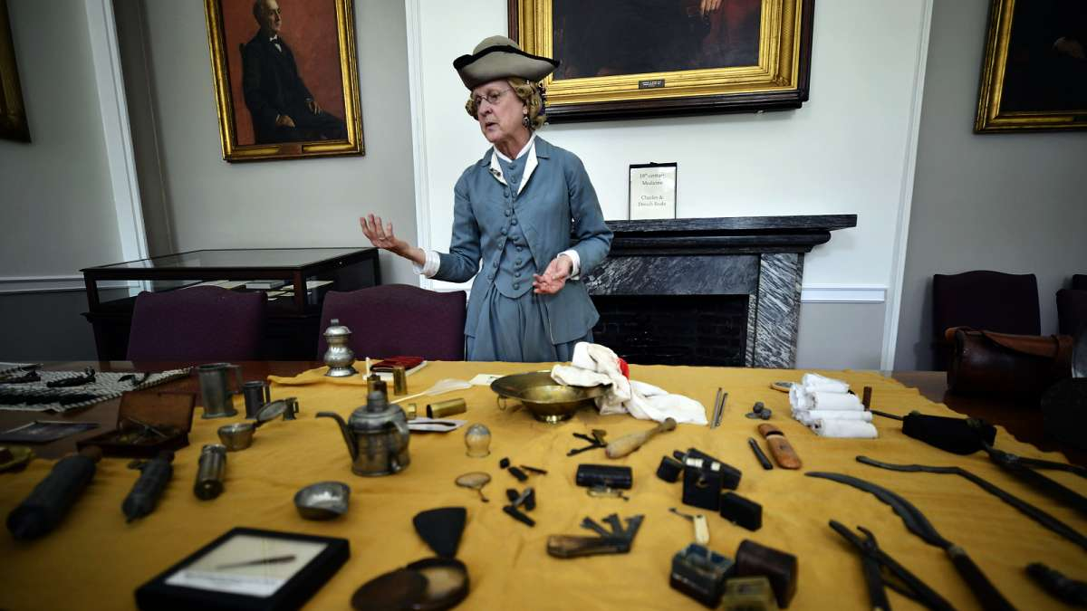 In the Apothecary Room at Pennsylvania Hospital, Donah Beala shows items from her collection of antique medical tools.