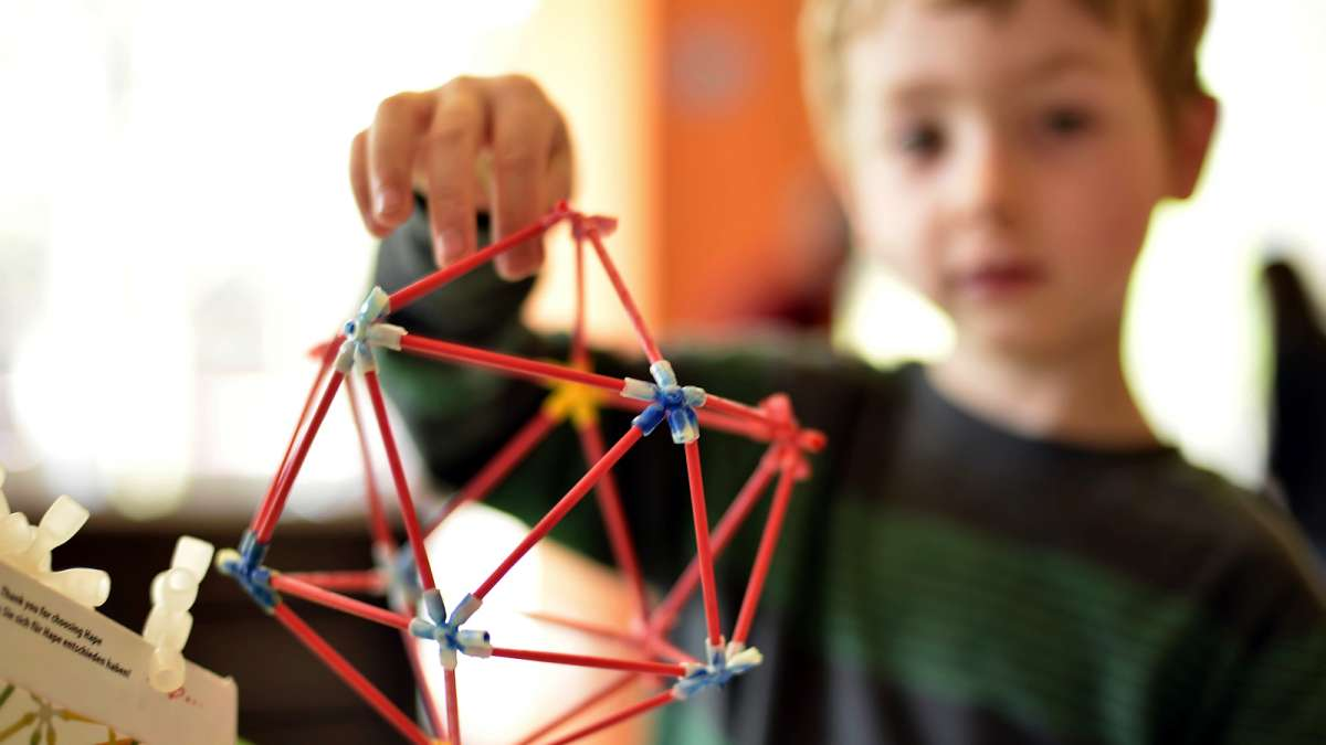 August Clayton, 5, builds a geodesic dome, a shape popularized by innovator Richard Buckminster Fuller.