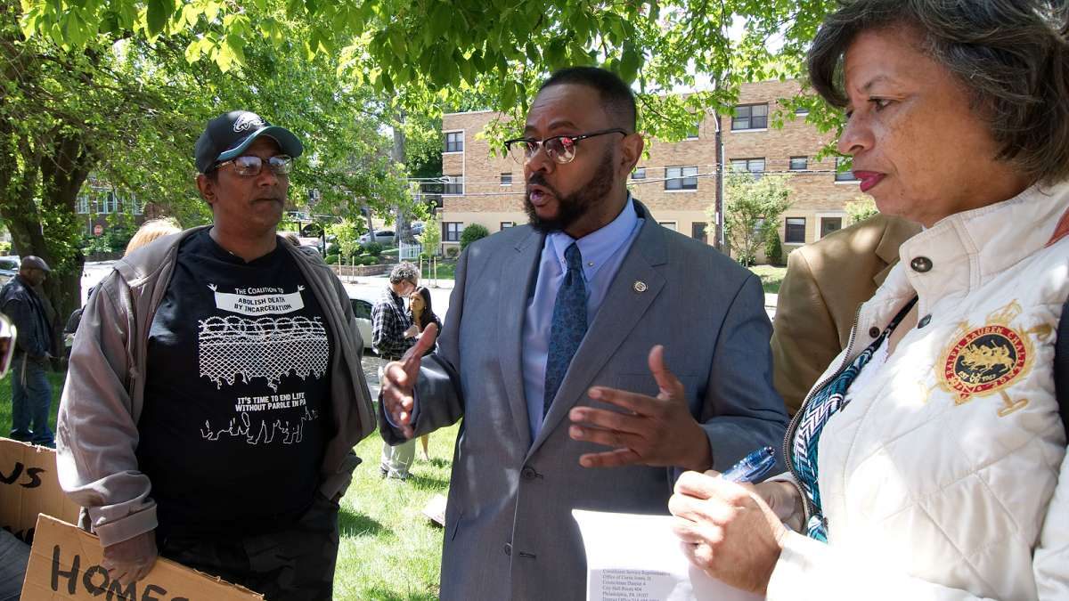 Councilman Curtis Jones, Jr. talks to residents after the anti-eviction rally at Penn Wynn House, on Wednesday.