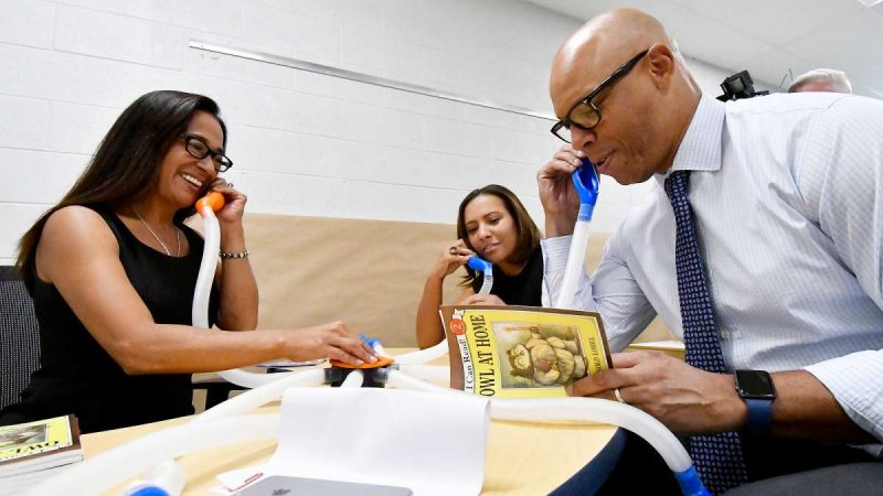 SPD Education facilities Planner Paula Sahm, Stearne Principal Mecca Jackson, and Superintendent Dr. William Hite demonstrate a whisper phone at Allen M. Stearne Elementary (Bastiaan Slabbers for WHYY)