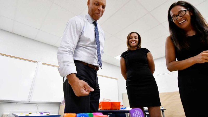 Superintendent Dr. William Hite, Stearne Principal Mecca Jackson and SPD Education facilities Planner Paula Sahm demonstrate some of the learning materials at Allen M. Stearne Elementary, in the Frankford Section of the city, on August 23, 2017. (Bastiaan Slabbers for WHYY)